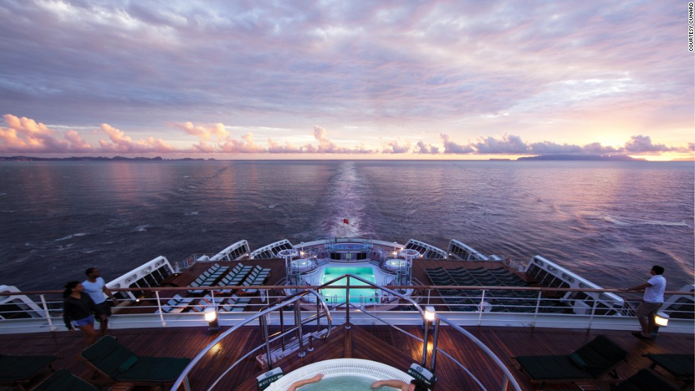 """To the planetarium or the ballroom after sunset cocktails?"" The <em>Queen Mary 2</em> makes a stylish nine-day cruise from New York to Hamburg, Germany. In 2004, it became the first transatlantic passenger liner built in 35 years."