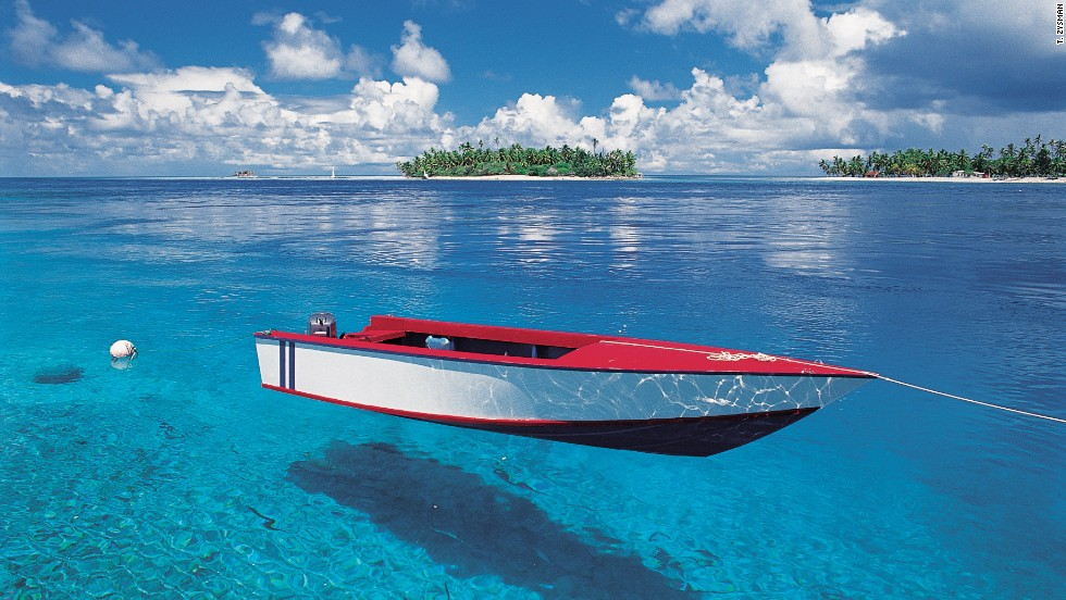 "Also part of the Society Islands, Rangiroa is called the ""infinite lagoon"" -- it's one of the largest atolls in the world. Divers around Rangiroa can spot tiger and hammerhead sharks, as well as dolphins, green turtles and eagle rays."