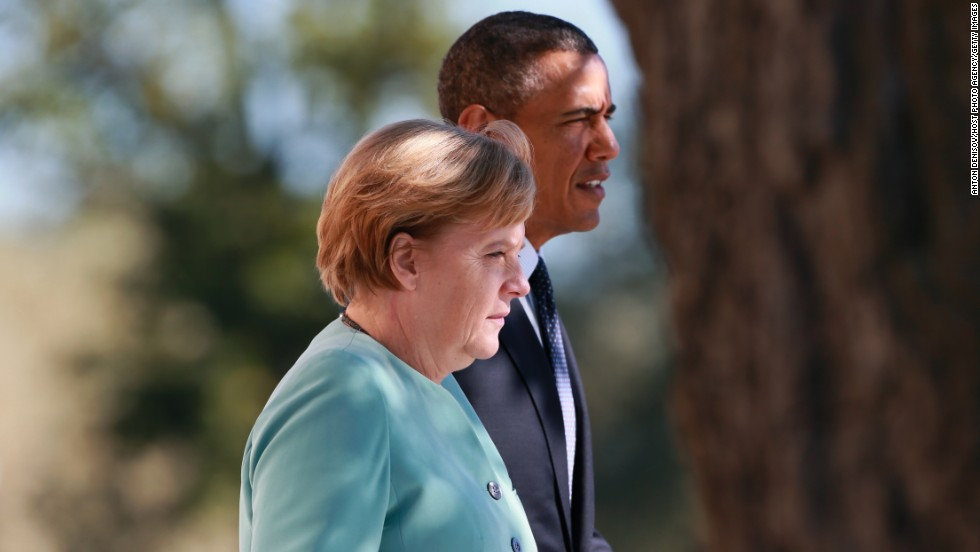 President Barack Obama and German Chancellor Angela Merkel arrive to pose with other leaders for a group photo during the G-20 Summit on September 6.