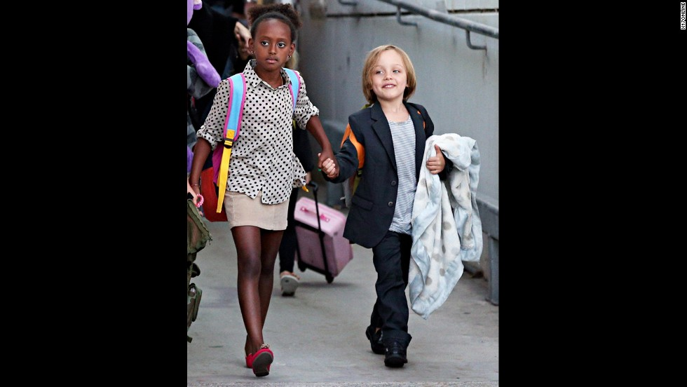 Zahara, now 8, is old enough to help lead her younger siblings through airports.