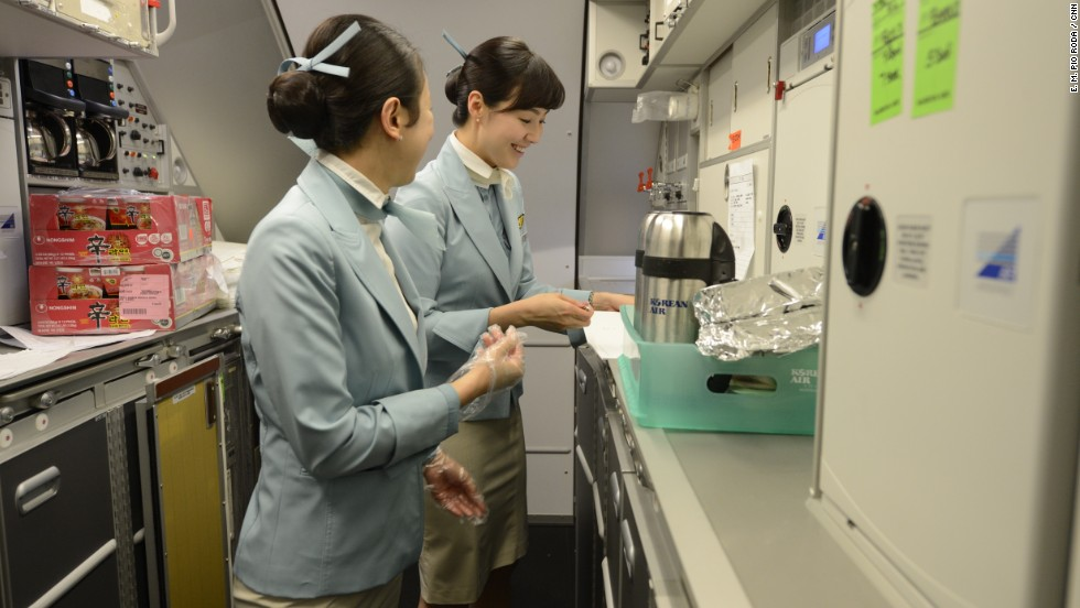 Korean Airlines flight attendants prepare for the return flight to Seoul in one of the A380's galleys.