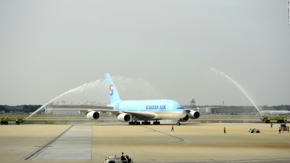 An Airbus A380 flown by Korean Airlines arrives at Hartsfield-Jackson Atlanta International Airport on Friday to a spectacular water cannon salute. The airport held a ceremony to welcome the world's largest airliner, which began nonstop service between Atlanta and Seoul this week.