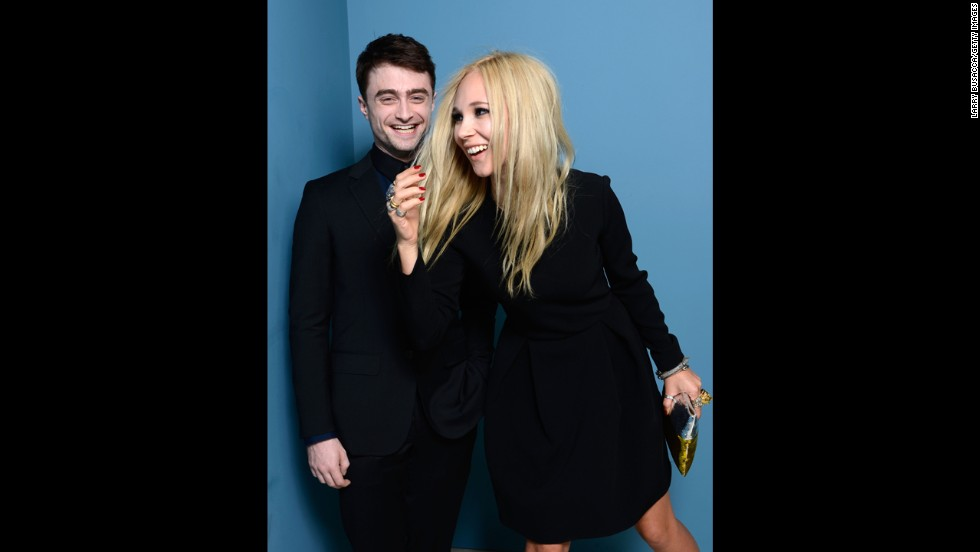 "Actors Daniel Radcliffe and Juno Temple of ""Horns"" pose at the Guess Portrait Studio on September 6."