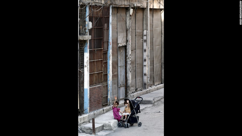 Two Syrian refugee children sit outside a house in Istanbul in September 2013.