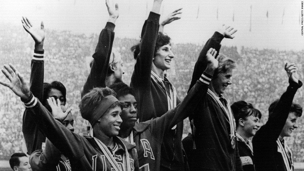 October 21, 1964: The Polish winners of the women's 4 x 100 meters relay race celebrate on the podium, with the American team who came second and the British team who came third.