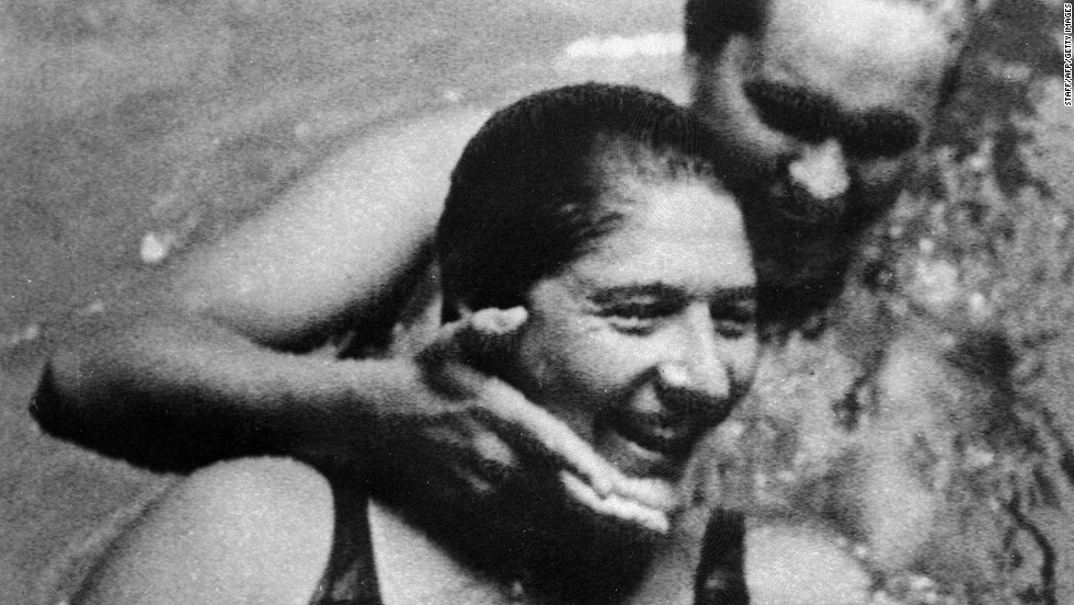 Australian swimming champion Dawn Fraser (in front) with her country fellow Linda McGill before the race where she set a new 100 meter record and became the first ever woman to finish in under a minute. During her career, she won eight Olympic freestyle medals, including four golds, and beat 27 world records.