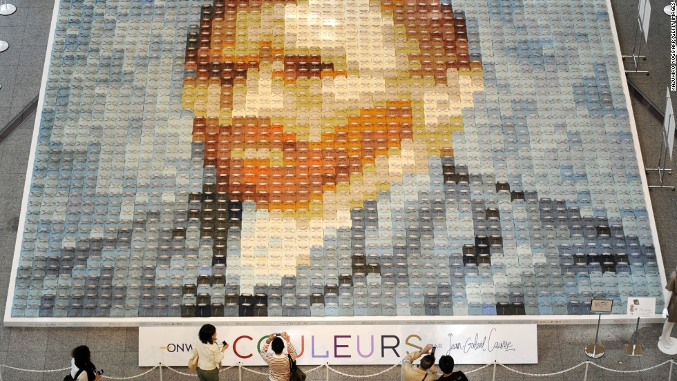 A huge reproduction of van Gogh's self-portrait made of 2,070 polo shirts in 24 different colors is displayed on the ground floor of the Marunouchi Building in Tokyo, Japan, in 2010, created by Japanese apparel company Onward Kashiyama.