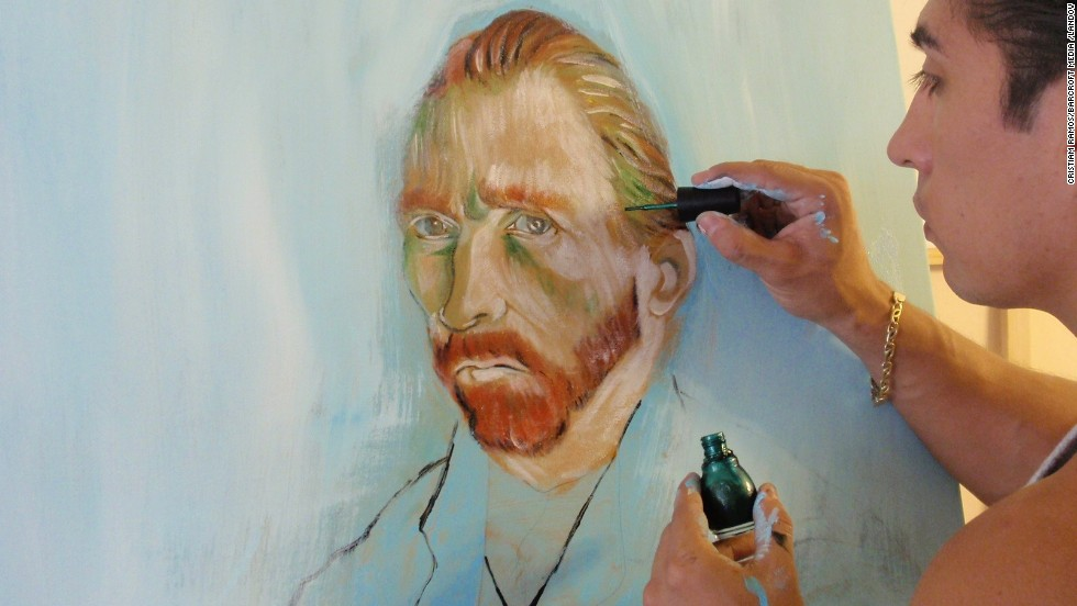 Artist Cristiam Ramos paints a version of van Gogh's self-portrait using nail polish at his studio in Orlando, Florida.