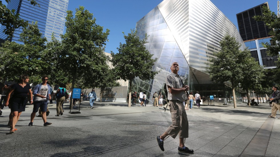 A visitor to the National September 11 Memorial & Museum takes in the sight as he walks past on September 6.