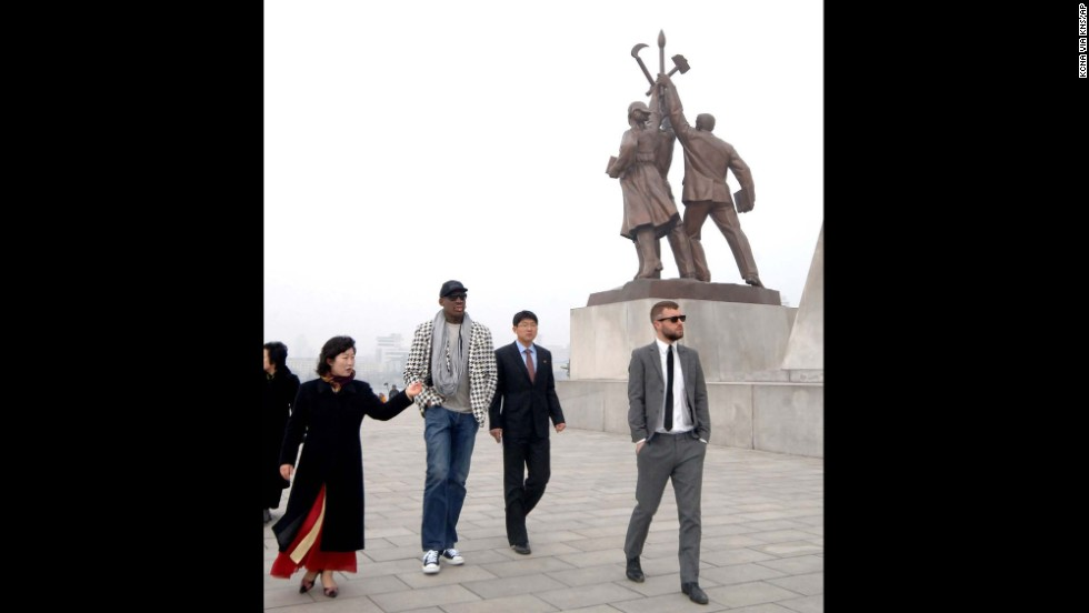 Rodman walks by the base of the Tower of the Juche Idea in Pyongyang in March 2013, in this image released by the Korean Central News Agency.
