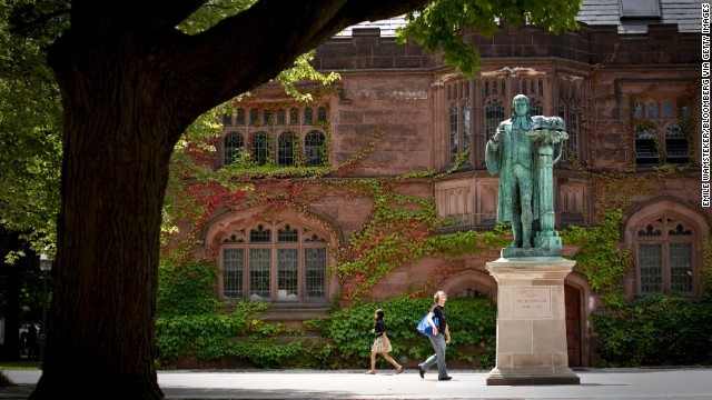 Pedestrians walk past a statue of former Princeton University president John Witherspoon near the East Pyne building on the school's campus in Princeton, New Jersey, in 2010.