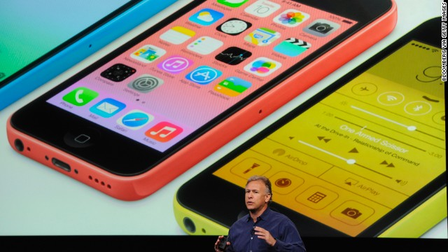 Apple's Phil Schiller presents the iPhone 5C, a cheaper, simpler version of the phone, at a September event.
