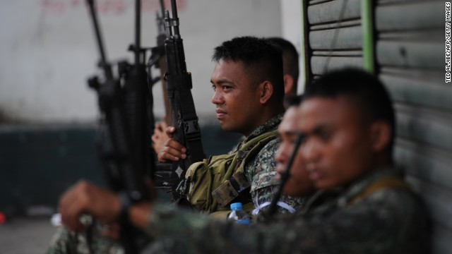 Philippine marines rest amid a lull in clashes with Muslim gunmen on the southern Philippine island of Mindanao on Tuesday.