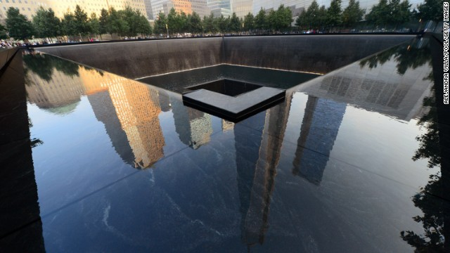 Buildings are reflected in one of the pools of the 9/11 Memorial in New York City on September 11, during ceremonies for the 12th anniversary of the terrorist attacks.