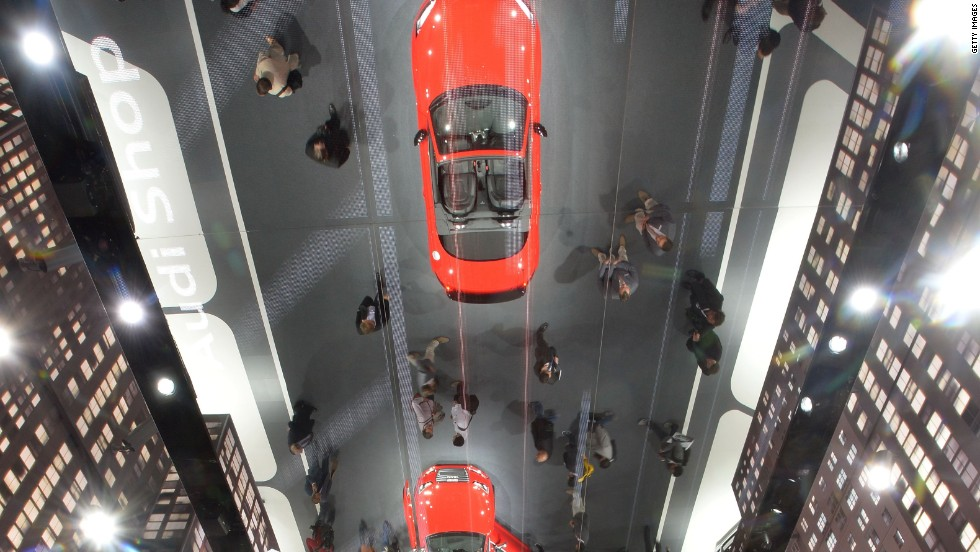 An Audi TTs 2.0 T quattro reflect in the mirror under the ceiling at the IAA international automobile show on September 10, 2013 in Frankfurt, Germany.