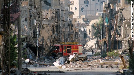 A picture shows a firetruck left amid heavily damaged buildings in the Syria's eastern town of Deir Ezzor on September 10, 2013. The United States is waiting to see a Russian proposal to put Syria's chemical weapons stock under international control, but will not wait for long, top diplomat John Kerry said.