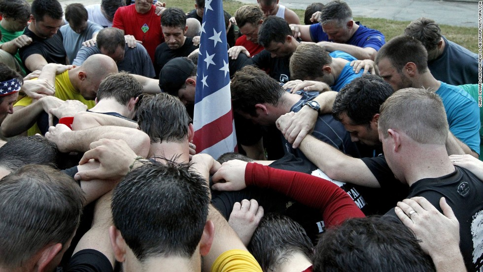 A group of men says prayers on September 11 in Raleigh, North Carolina, for those who died in the terror attacks.