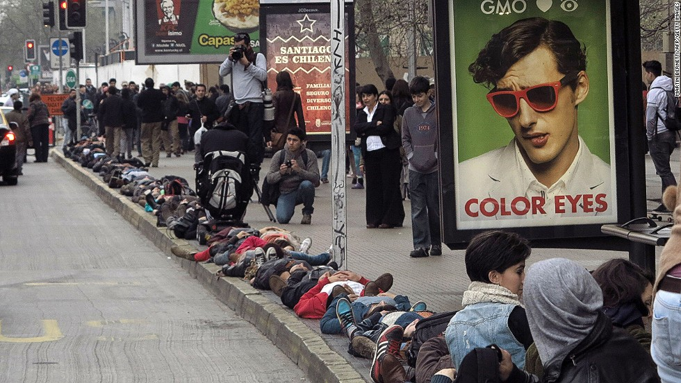 A thousand people lay down on the sidewalk along Alameda main avenue during a commemorative action in Santiago, on September 10, 2013. The protest represents the people missing during the dictatorship.