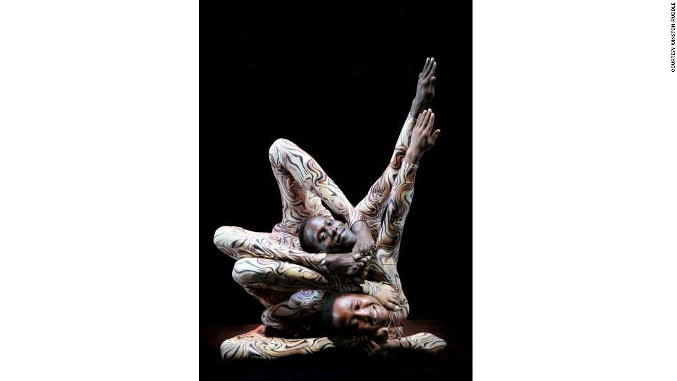 """Three years later """"Mama Africa"""" was born, a circus show featuring 50 acrobats, aerialists, clowns, magicians, and of course contortionists. Here, Gitu performs with fellow contortionist Hassan Mohamed in an act called """"the Plastic Boys."""""""