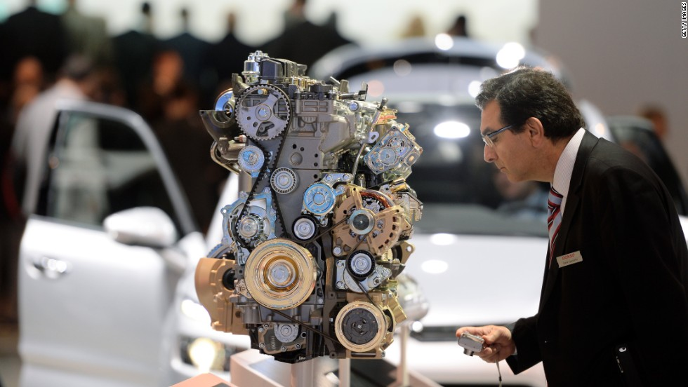 A visitor looks at an Citroen diesel enging at the IAA international automobile show on September 11, 2013 in Frankfurt, Germany.