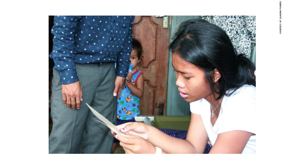 """U.S. adoptee Srey Powers traveled to Cambodia in 2010 to find her birth family. Powers: """"Here I'm seeing a picture of my mother for the first time."""""""