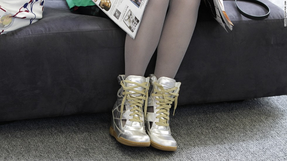 A guest at New York Fashion Week shows off her silver sneaker wedges.