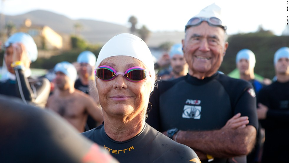 """Timme prepares to enter the water for the first leg of the race early Sunday morning. At the beginning of the year, she couldn't even put her face in the water while swimming. During the midway trip to Florida she <a href=""""http://www.cnn.com/2013/05/17/health/fit-nation-timme-midway-trip"""">entered the ocean for the first time</a>."""