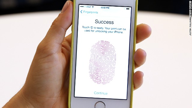 The new iPhone 5S with fingerprint technology is displayed at an Apple product announcement September 10 in California.