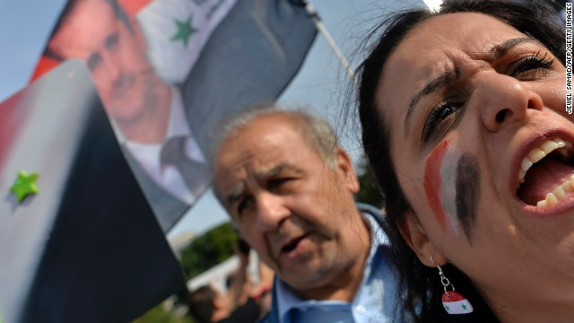 Supporters of Syrian President Bashar Al-Assad take part in a demonstration in front of the White House in Washington, DC, on September 9, 2013 urging US not to attack Syria. US Presidents Barack Obama and Bashar Al-Assad will go head-to-head in dueling US television interviews Monday, as a crucial week dawns for the US leader's push for air attacks on Syria. Assad denied that he used chemical weapons on civilians, as Obama makes a long-odds push to reverse his nation's mood and win support for punishing the Damascus regime for flouting taboos on the use of such arms. AFP Photo/Jewel Samad (Photo credit should read JEWEL SAMAD/AFP/Getty Images)