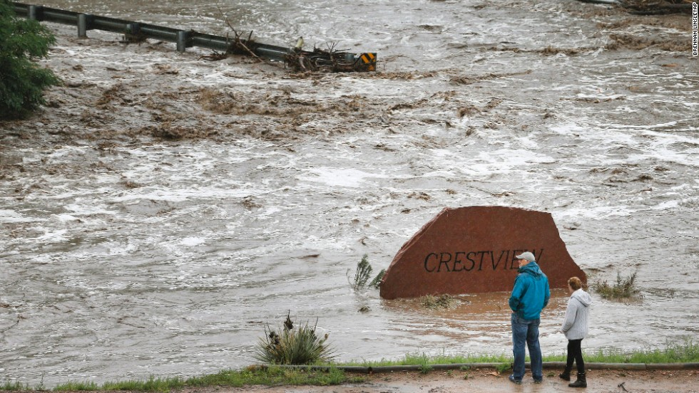 Residents view a road washed out by a torrent of water after overnight flash flooding near Left Hand Canyon, Colorado, on September 12.