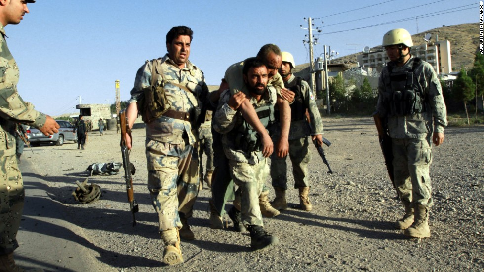 Afghan security officials help an injured colleague at the scene of an attack on September 13.  At least three Afghan security officials were killed. The Taliban claimed responsibility for the attack in an e-mail to CNN.
