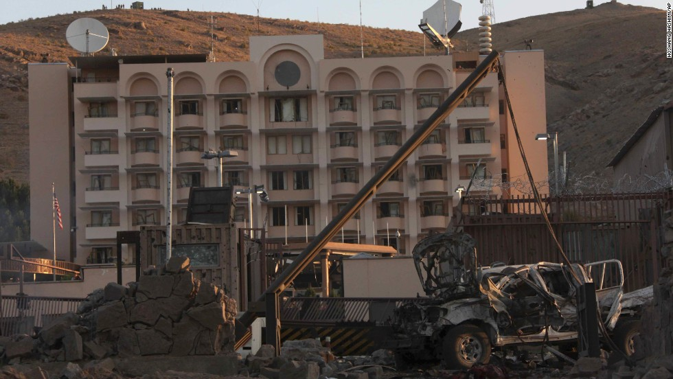 A damaged vehicle sits in front of the U.S. consulate on September 13. American consulate personnel took shelter in safe havens while U.S. security forces responded to the attack, Marie Harf, a deputy State Department spokeswoman, said. There were no U.S. casualties.