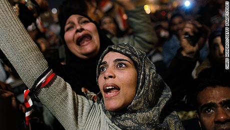 CAIRO, EGYPT - A woman cheers in Tahrir Square after it is announced that Egyptian President Hosni Mubarak was giving up power February 11, 2011 in Cairo, Egypt. After 18 days of widespread protests, Egyptian President Hosni Mubarak, announced that he would step down.