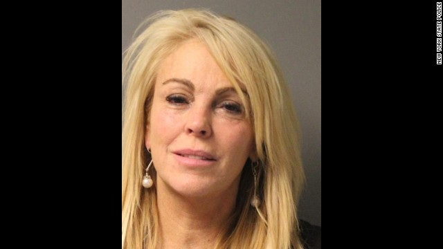 Dina Lohan's police booking photo following her arrest in New York on September 12, 2013 on DWI charges.