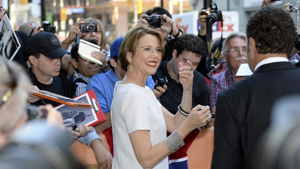 "Actress Annette Bening signs autographs at the premiere of her film ""The Face of Love"" on September 12."
