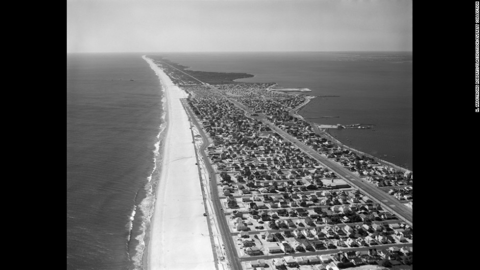 Aerial view of Seaside Park, New Jersey, made during a period during the 1970's or 1980's. The Seaside Heights boardwalk was completed in 1921 but was later extended in 1932 to include the Casino Pier.