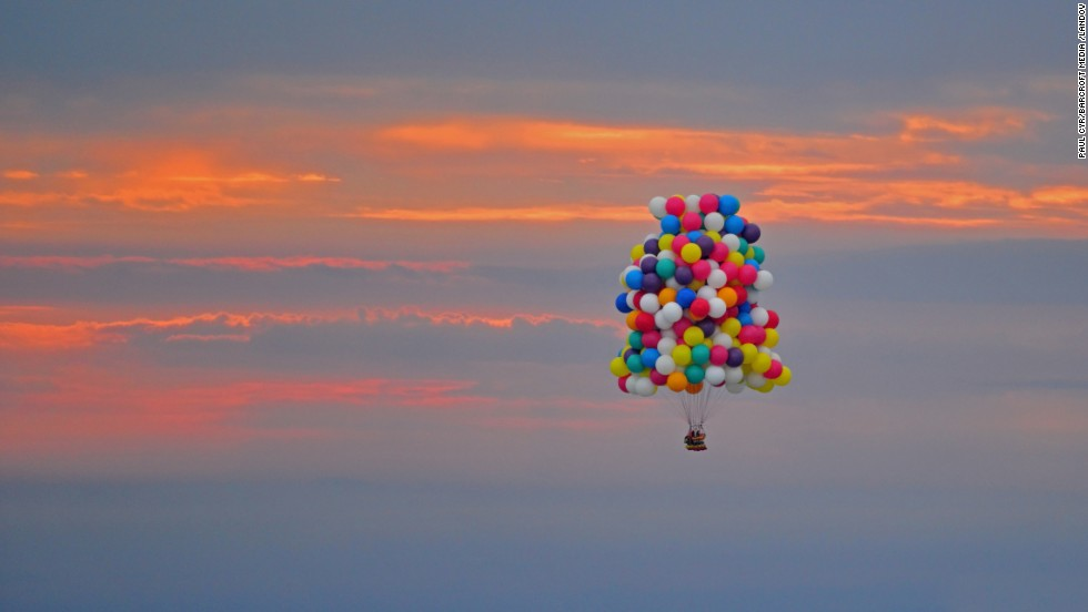 "<a href=""http://edition.cnn.com/2013/09/13/world/americas/atlantic-balloon-crossing-aborted/"">Jonathan Trappe</a>, a fearless adventurer, has taken to the skies in a bid to become the first man to successfully cross the Atlantic Ocean in a balloon cluster. Trappe took off from Caribou, Maine, on Thursday morning, September 12, to begin a 2,500 mile journey across the Atlantic Ocean."