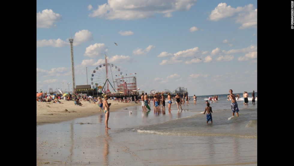Bathers play in the surf in Seaside Park in 2012. New Jersey focused on cooperation among regional tourism leaders to promote the shore as it recovered from Superstorm Sandy. In the background is the Funtown Pier in Seaside Heights.