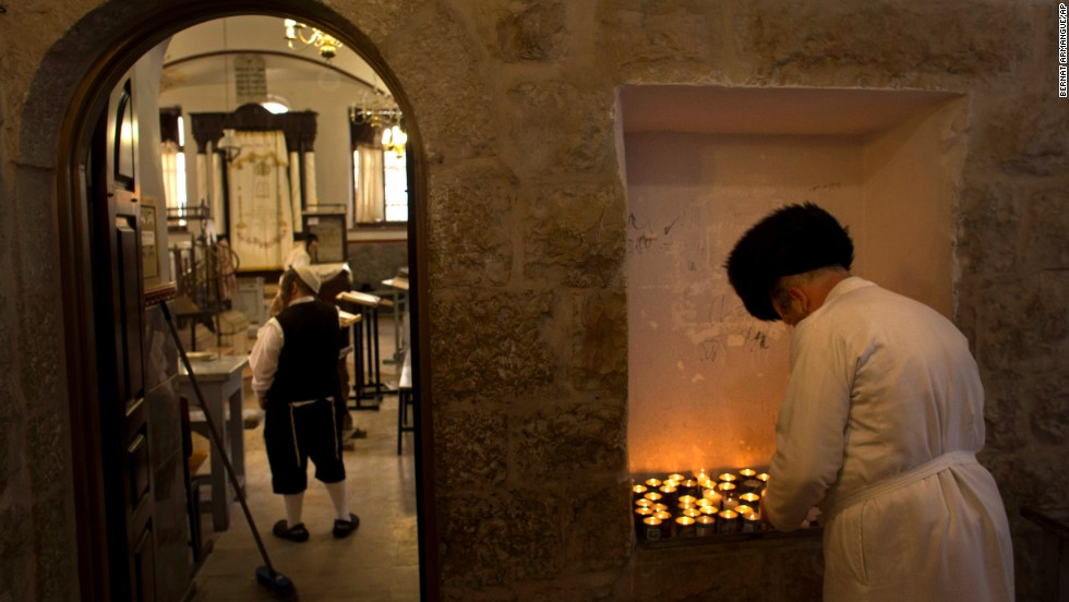 An ultra-Orthodox Jewish man lights a candle ahead of Yom Kippur in Jerusalem on September 13.