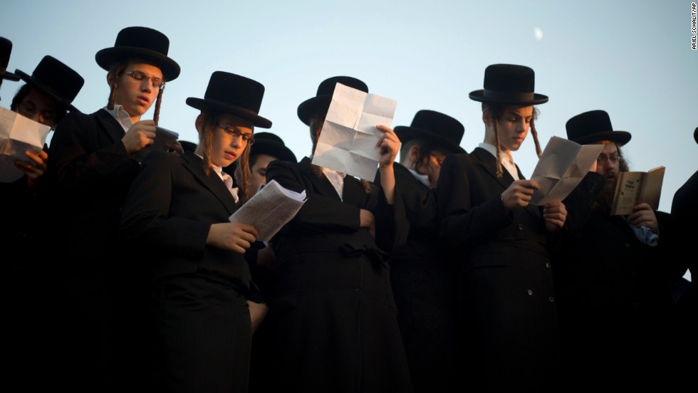 Ultra-Orthodox Jews pray on the Ayarkon River banks as they participate in a Tashlich ceremony in the ultra-Orthodox Israeli town of Ramat Gan, near Tel Aviv, on September 12.