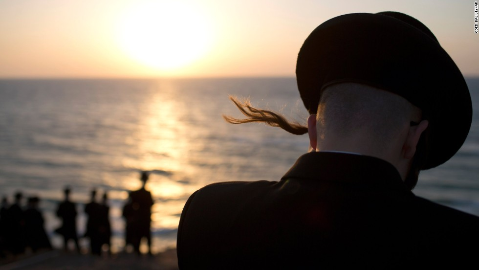 Ultra-Orthodox Jews of the Hasidic sect Vizhnitz gather on a hill overlooking the Mediterranean Sea as they participate in a Tashlich ceremony in Herzeliya, Israel, on September 12.