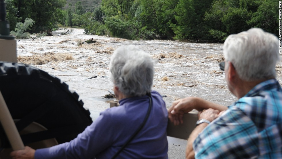 Dick and LaRue Vodime, temporary residents of Lyons, witness some of the destruction from the floods as they are evacuated to Longmont on September 13.