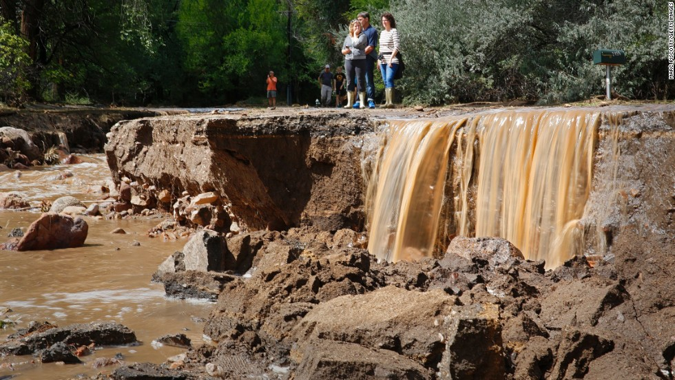 Residents look at the flood damage along Topaz Street in Boulder on September 13.