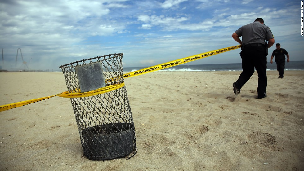 Police officers put up crime tape to keep people away from the destroyed remains of businesses along the boardwalk on September 13.