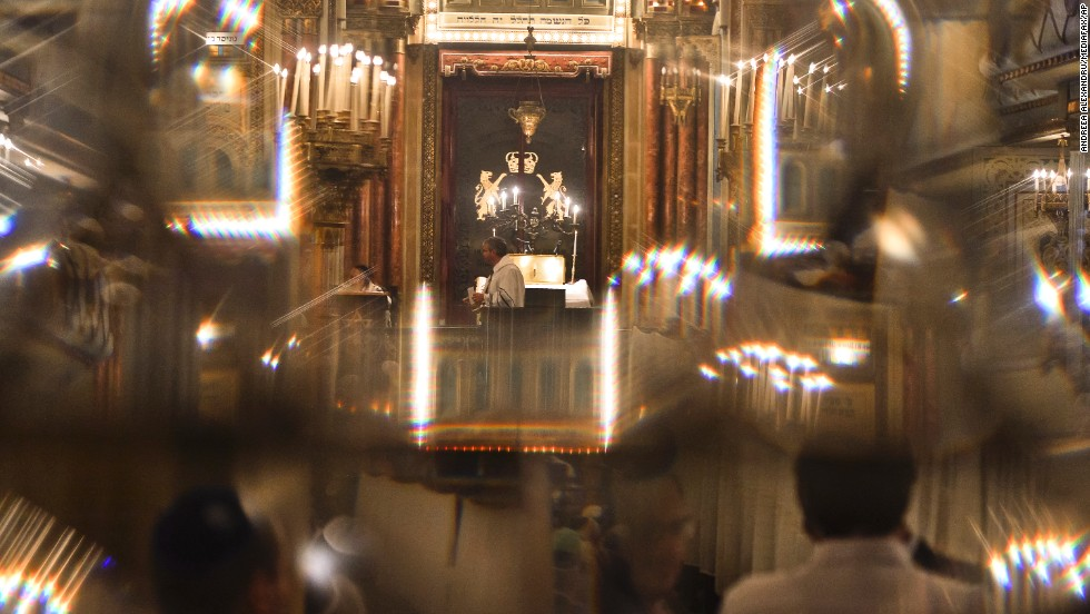 Romanian Jews, seen through a glass door, attend a religious service ahead of Yom Kippur at the Great Synagogue in Bucharest, Romania, on September 13.