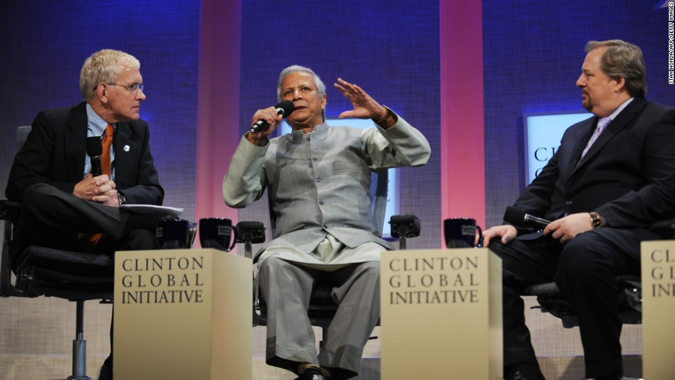 Warren, right, attends the Clinton Global Initiative on September 26, 2008, in New York with  Steve Gunderson, left, president and CEO of the Council on Foundations, and Muhammad Yunus, the founder and managing director of the Grameen Bank. The three-day event aimed to bring together global leaders to develop and implement workable solutions to some of the world's most pressing challenges.