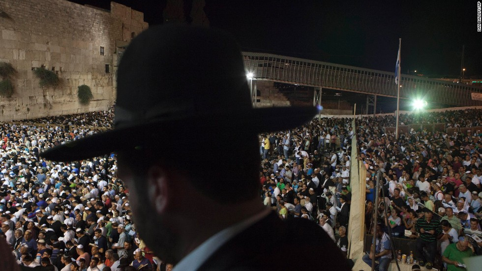 Men and women participate in a Selichot prayer ahead of the Jewish holiday of Yom Kippur at the Western Wall in Jerusalem on Friday, September 13. Selichot is Hebrew for forgiveness.