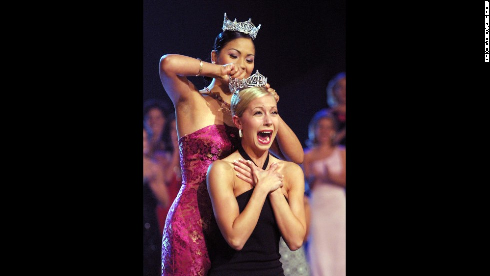 Miss America 2002, Katie Harman, clasps her hands together, overjoyed as she assumes the title of Miss America 2002.