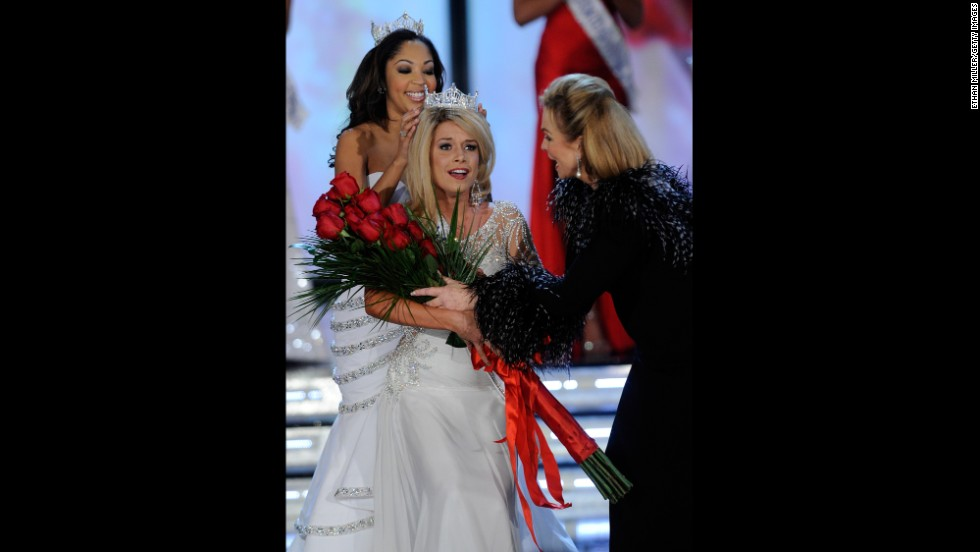Teresa Scanlan, from Nebraska, is crowned Miss America 2011 as Miss America 1971, Phyllis George, right, gives Scanlan flowers.