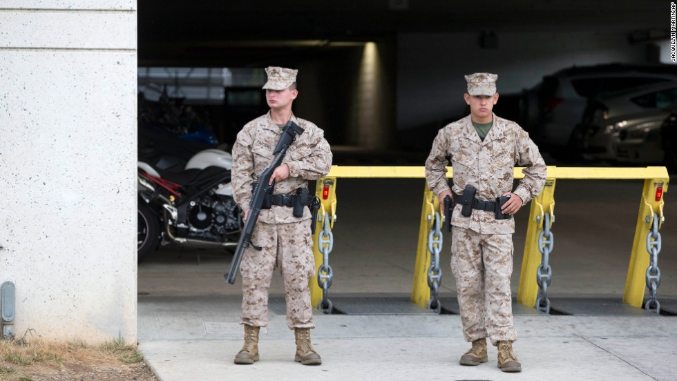 Troops stand guard in front of a parking garage near the Washington Navy Yard.